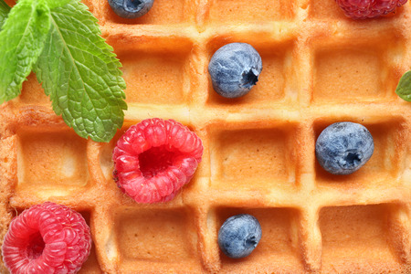 Closeup view of delicious waffle with berries