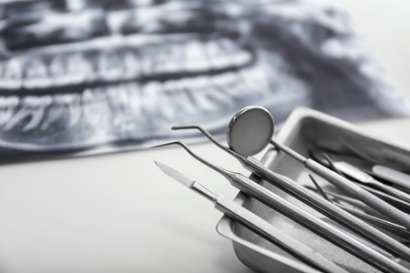 Tray with dentists tools on light table