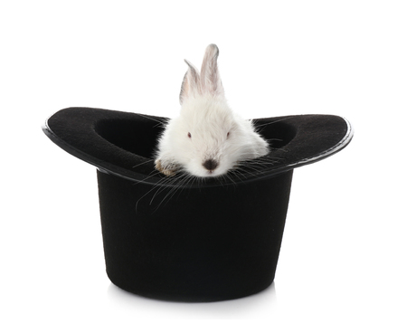 Magician hat with cute rabbit on white background Stock Photo