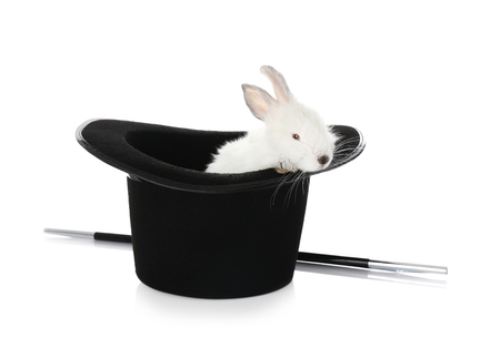 Magician hat with cute rabbit on white background Фото со стока