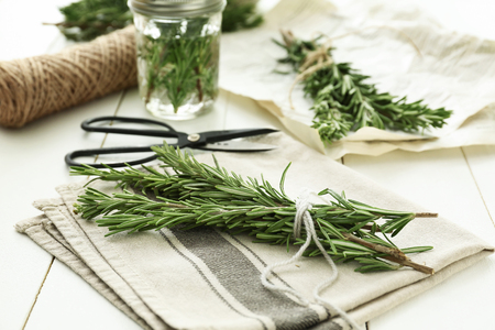 Fresh rosemary twigs on table
