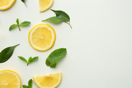 Flat lay composition with lemon slices on white background