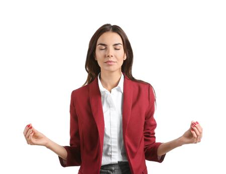 Beautiful businesswoman meditating on white background