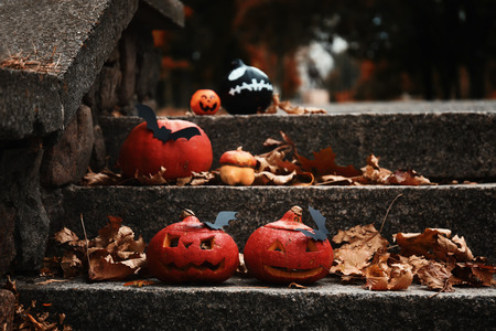 Halloween pumpkins with creative decorations on stairs outdoors 스톡 콘텐츠