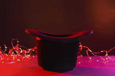 Black magician hat on dark color background Stock Photo