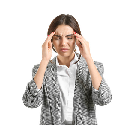 Beautiful stressed businesswoman suffering from headache on white background