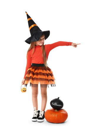Cute little girl dressed as witch for Halloween on white background
