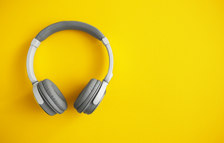 Modern headphones on color background