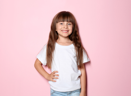 Little girl in t-shirt on color background Stok Fotoğraf