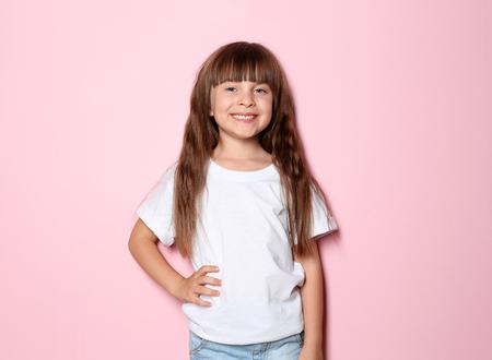 Little girl in t-shirt on color background 免版税图像