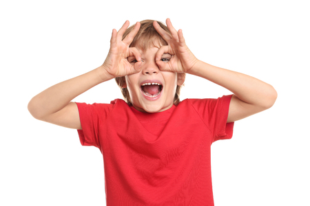 Funny little boy in t-shirt on white background 스톡 콘텐츠
