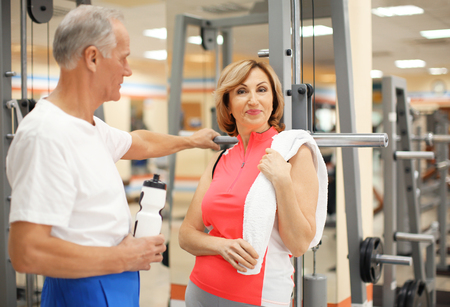 Mature people in modern gym