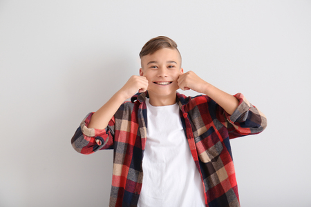 Funny teenage boy on white background