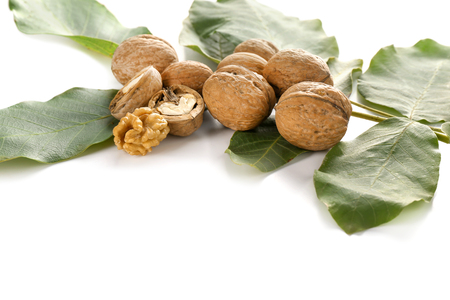 Walnuts with green leaves on white background Banco de Imagens