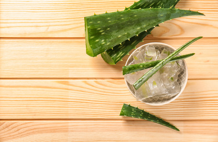 Bowl with aloe vera on wooden table