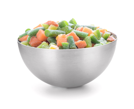 Bowl with frozen vegetables on white background