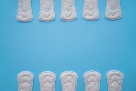 Menstrual pads on color background, top view Stock Photo
