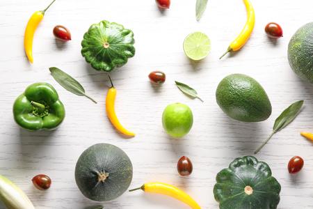 Various fresh vegetables on white wooden background
