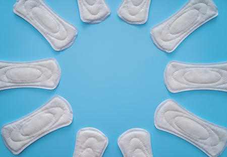 Frame made of menstrual pads on color background Stock Photo
