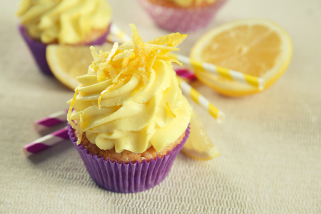 Delicious lemon cupcake on table