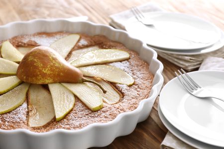 Delicious pear cake on wooden table, closeup