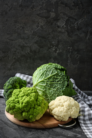 Different kinds of cabbage on wooden board 스톡 콘텐츠