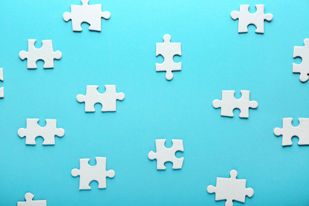 Pieces of jigsaw puzzle on color background Stock Photo