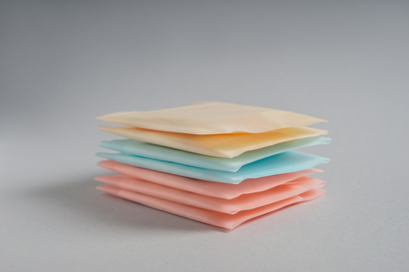 Stack of menstrual pads on grey background