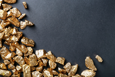 Gold nuggets on black background