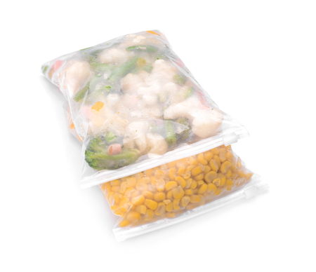Plastic bags with frozen vegetables on white background Banque d'images - 116101503