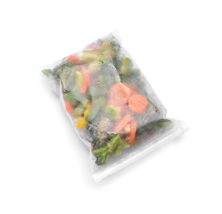 Plastic bag with frozen vegetables on white background