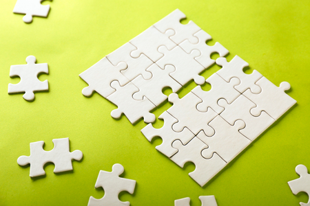 Incomplete jigsaw puzzle on color background