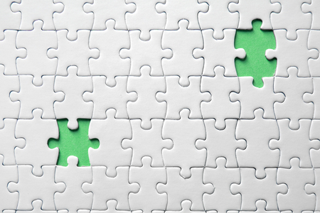 Jigsaw puzzle with missing fragments Standard-Bild - 116650479