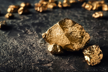 Gold nuggets on dark background