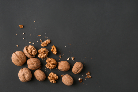 Tasty walnuts on dark background Imagens