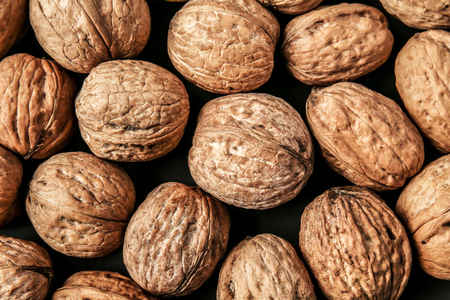 Unpeeled walnuts as background 스톡 콘텐츠