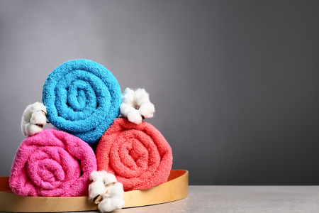 Clean colorful towels on grey table Stok Fotoğraf