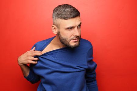 Portrait of crazy man on color background Stok Fotoğraf