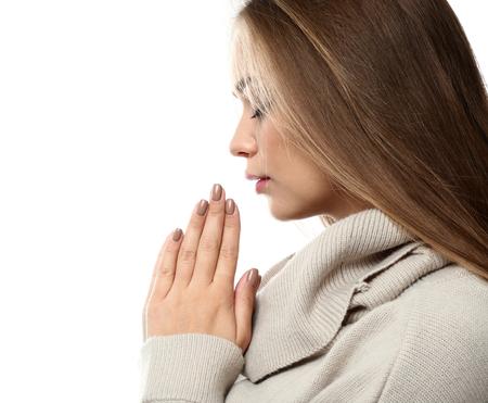 Beautiful young woman praying on white background Stok Fotoğraf