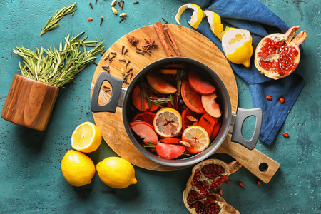 Saucepan of delicious mulled wine on wooden board Stok Fotoğraf