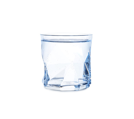 Glass of cold fresh water on white background