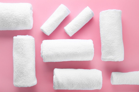 Clean soft towels on color background 스톡 콘텐츠