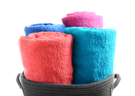 Clean rolled towels on white background