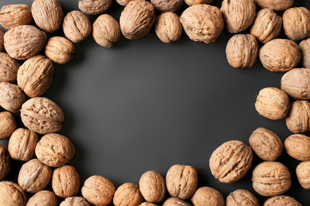Unpeeled walnuts on dark background
