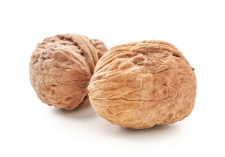 Unpeeled walnuts on white background