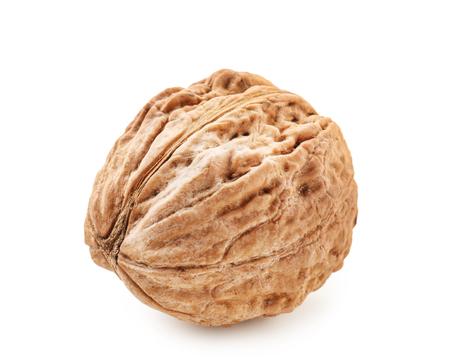 Unpeeled walnut on white background