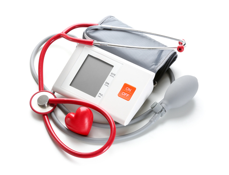 Sphygmomanometer with red heart and stethoscope on white background