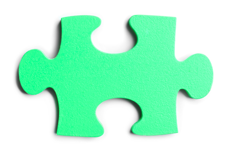 Piece of jigsaw puzzle on white background