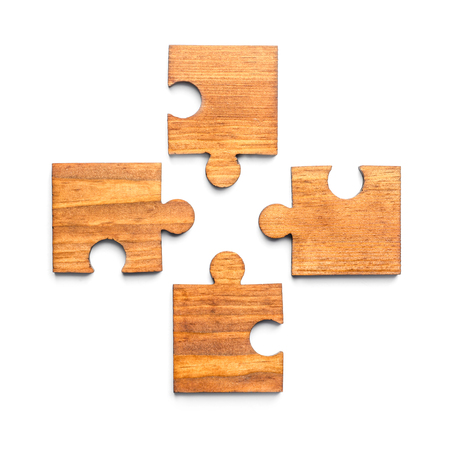 Pieces of wooden puzzle on white background