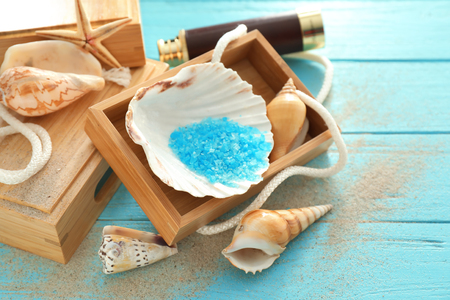 Composition with different sea shells on color wooden background Stock Photo